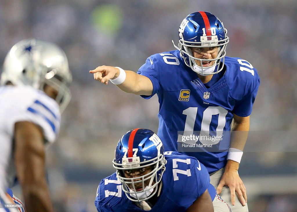 Quarterback Eli Manning of the New York Giants calls out from under center in the first quarter against the Dallas Cowboys in the first half on...