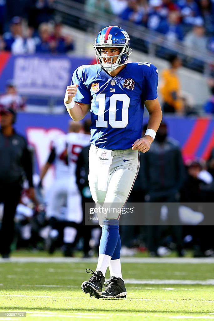 Quarterback Eli Manning #10 of the New York Giants celebrates a play in the fourth quarter against the Atlanta Falcons during their game at MetLife Stadium on October 5, 2014 in East Rutherford, New Jersey.
