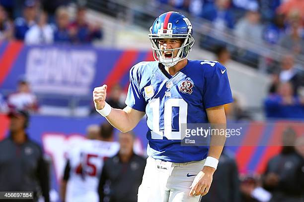 Quarterback Eli Manning of the New York Giants celebrates a play in the fourth quarter against the Atlanta Falcons during their game at MetLife...
