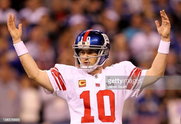 Quarterback Eli Manning of the New York Giants celebrates after Runningback Ahmad Bradshaw ran the ball for a 6 yard touchdown in the fourth quarter...