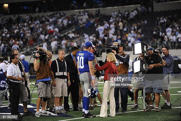 Quarterback Eli Manning of the New York Giants does an interview at Cowboys Stadium on September 20 2009 in Arlington Texas
