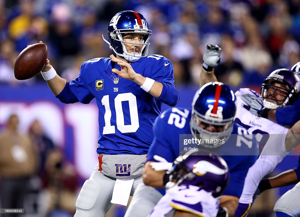 Quarterback Eli Manning #10 of the New York Giants drops back to pass against the Minnesota Vikings during a game at MetLife Stadium on October 21, 2013 in East Rutherford, New Jersey.