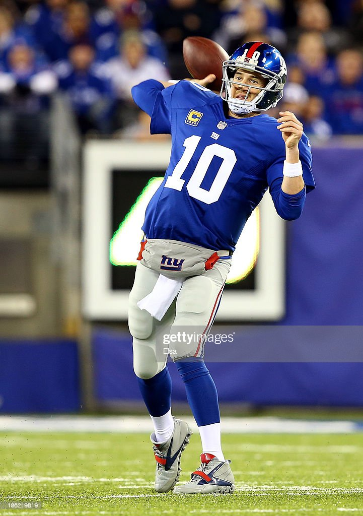 Quarterback <a gi-track='captionPersonalityLinkClicked' href=/galleries/search?phrase=Eli+Manning&family=editorial&specificpeople=202013 ng-click='$event.stopPropagation()'>Eli Manning</a> #10 of the New York Giants drops back to pass against the Minnesota Vikings during a game at MetLife Stadium on October 21, 2013 in East Rutherford, New Jersey.