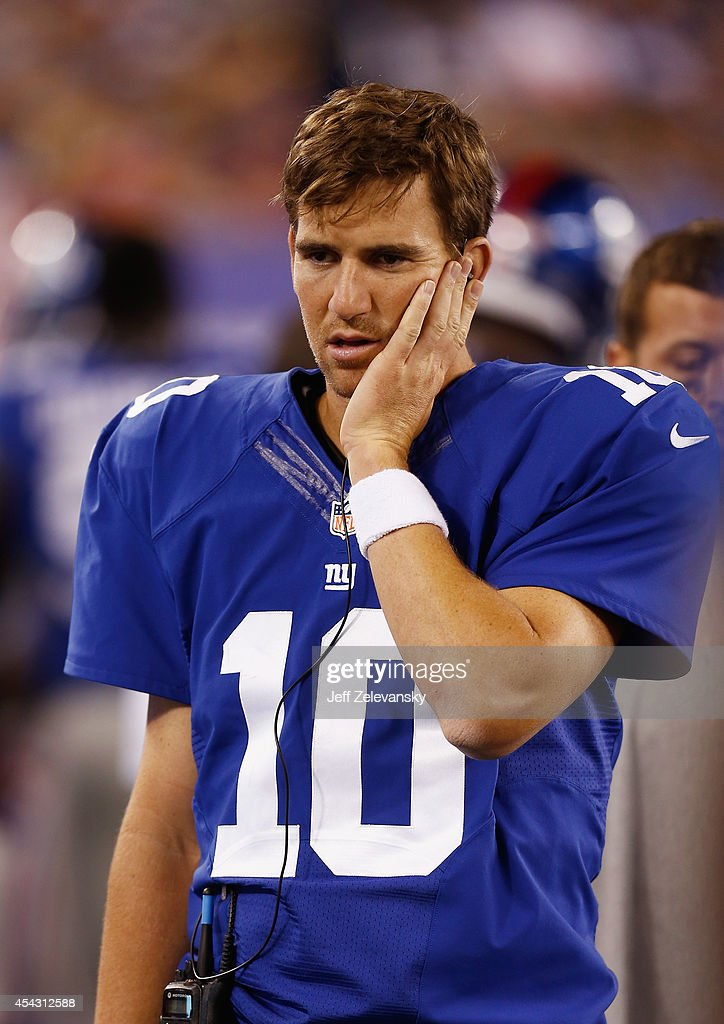 Quarterback <a gi-track='captionPersonalityLinkClicked' href=/galleries/search?phrase=Eli+Manning&family=editorial&specificpeople=202013 ng-click='$event.stopPropagation()'>Eli Manning</a> #10 of the New York Giants looks on from the sideline in the second half during the preseason game against the New England Patriots at MetLife Stadium on August 28, 2014 in East Rutherford, New Jersey. The Giants won 16-13.