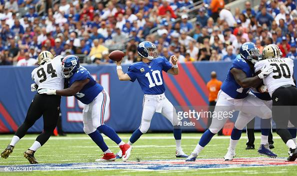 Quarterback Eli Manning of the New York Giants looks to pass against the New Orleans Saints during the first quarter at MetLife Stadium on September...