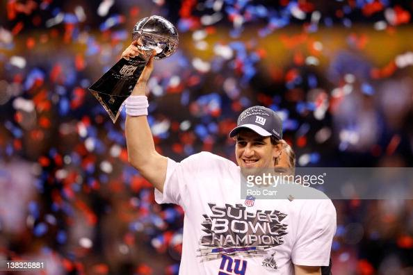 Quarterback Eli Manning of the New York Giants poses with the Vince Lombardi Trophy after the Giants defeated the Patriots by a score of 2117 in...
