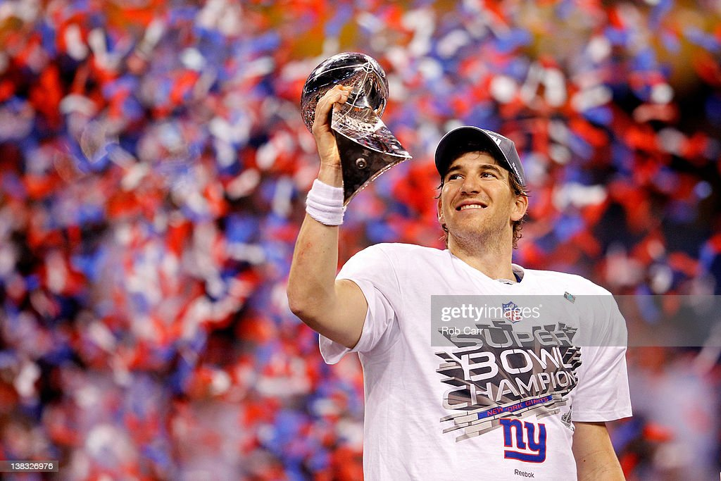 Quarterback <a gi-track='captionPersonalityLinkClicked' href=/galleries/search?phrase=Eli+Manning&family=editorial&specificpeople=202013 ng-click='$event.stopPropagation()'>Eli Manning</a> #10 of the New York Giants poses with the Vince Lombardi Trophy after the Giants defeated the Patriots by a score of 21-17 in Super Bowl XLVI at Lucas Oil Stadium on February 5, 2012 in Indianapolis, Indiana.