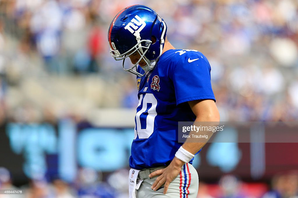 Quarterback <a gi-track='captionPersonalityLinkClicked' href=/galleries/search?phrase=Eli+Manning&family=editorial&specificpeople=202013 ng-click='$event.stopPropagation()'>Eli Manning</a> #10 of the New York Giants reacts after a fumble in the fourth quarter against the Arizona Cardinals during a game at MetLife Stadium on September 14, 2014 in East Rutherford, New Jersey.