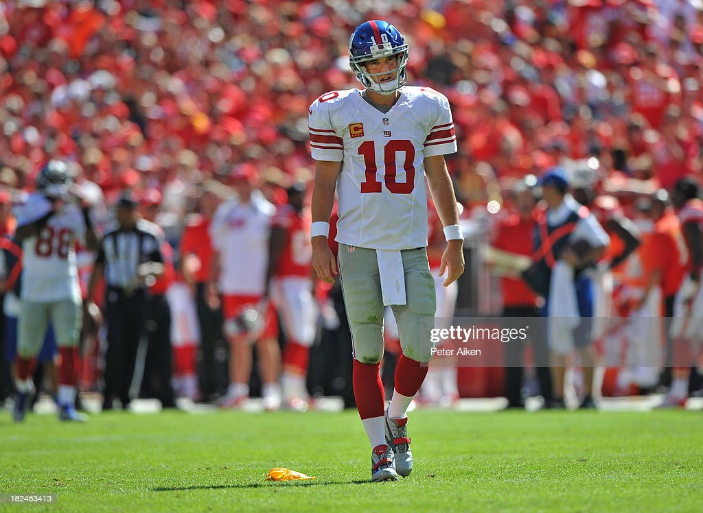 Quarterback <a gi-track='captionPersonalityLinkClicked' href=/galleries/search?phrase=Eli+Manning&family=editorial&specificpeople=202013 ng-click='$event.stopPropagation()'>Eli Manning</a> #10 of the New York Giants reacts after a holding call against the Giants during the second half against the Kansas City Chiefs on September 29, 2013 at Arrowhead Stadium in Kansas City, Missouri. Kansas City defeated New York 31-7.