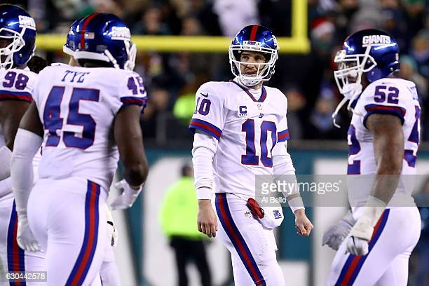 Quarterback Eli Manning of the New York Giants reacts after throwing an interception to Defensive back Terrence Brooks of the Philadelphia Eagles...