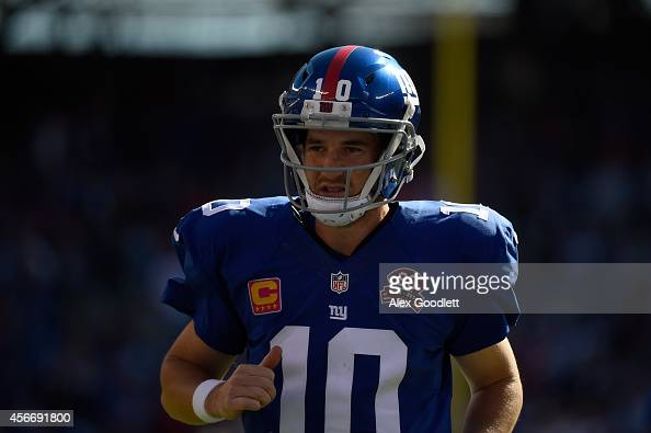 Quarterback Eli Manning of the New York Giants runs off the field at the end of the first half against the Atlanta Falcons during their game at...