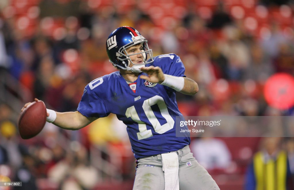 Quarterback Eli Manning of the New York Giants sets to pass during the game against the Washington Redskins at Fed Ex Field on December 5 2004 in...