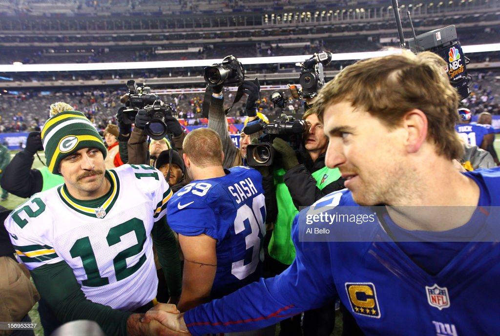 Quarterback <a gi-track='captionPersonalityLinkClicked' href=/galleries/search?phrase=Eli+Manning&family=editorial&specificpeople=202013 ng-click='$event.stopPropagation()'>Eli Manning</a> #10 of the New York Giants shakes hands with quarterback <a gi-track='captionPersonalityLinkClicked' href=/galleries/search?phrase=Aaron+Rodgers+-+American+Football+Quarterback&family=editorial&specificpeople=215257 ng-click='$event.stopPropagation()'>Aaron Rodgers</a> #12 of the Green Bay Packers after defeating the New York Giants defeating the Green Bay Packers by a score of 38-10 at MetLife Stadium on November 25, 2012 in East Rutherford, New Jersey.
