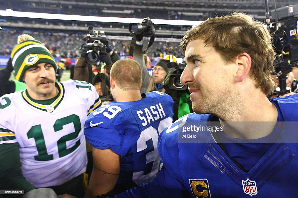 Quarterback <a gi-track='captionPersonalityLinkClicked' href=/galleries/search?phrase=Eli+Manning&family=editorial&specificpeople=202013 ng-click='$event.stopPropagation()'>Eli Manning</a> #10 of the New York Giants shakes hands with quarterback <a gi-track='captionPersonalityLinkClicked' href=/galleries/search?phrase=Aaron+Rodgers+-+American+football-quarterback&family=editorial&specificpeople=215257 ng-click='$event.stopPropagation()'>Aaron Rodgers</a> #12 of the Green Bay Packers after defeating the New York Giants defeating the Green Bay Packers by a score of 38-10 at MetLife Stadium on November 25, 2012 in East Rutherford, New Jersey.