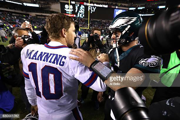 Quarterback Eli Manning of the New York Giants shakes hands with quarterback Carson Wentz of the Philadelphia Eagles after their game at Lincoln...