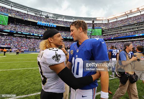 Quarterback Eli Manning of the New York Giants talks with Willie Snead IV of the New Orleans Saints after their game at MetLife Stadium on September...