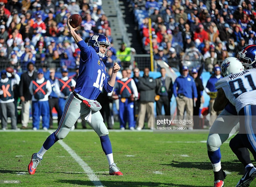 Quarterback Eli Manning of the New York Giants throws a pass against the Tennessee Titans during the second quarter in a game at LP Field on December...