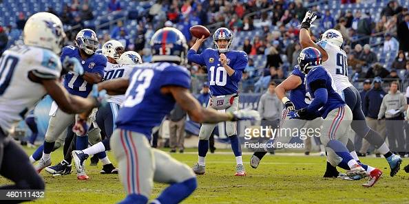 Quarterback Eli Manning of the New York Giants throws a pass against the Tennessee Titans during the second half of a game at LP Field on December 7...