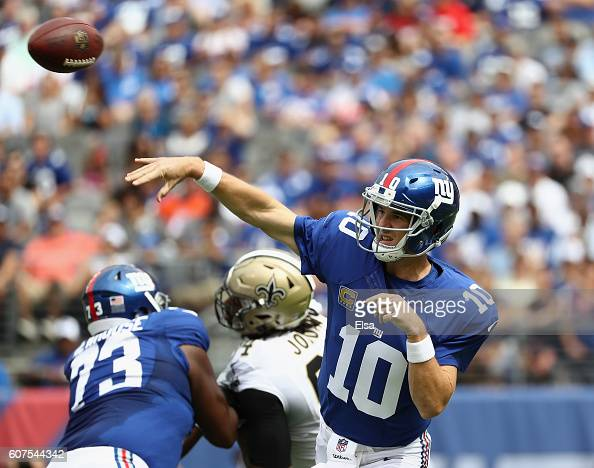 Quarterback Eli Manning of the New York Giants throws a pass against the New Orleans Saints during the first quarter at MetLife Stadium on September...