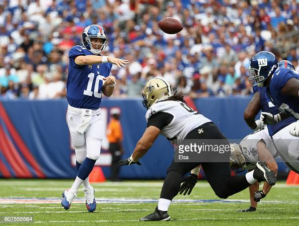 Quarterback Eli Manning of the New York Giants throws a pass against the New Orleans Saints during the second half at MetLife Stadium on September 18...