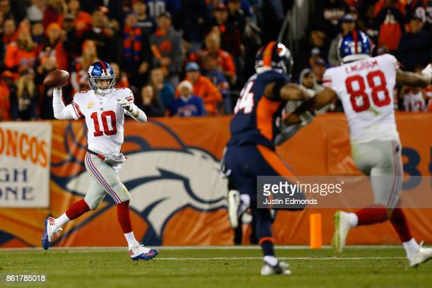 Quarterback Eli Manning of the New York Giants throws a pass on the run as Evan Engram tries to get open while being defended by Inside Linebacker...
