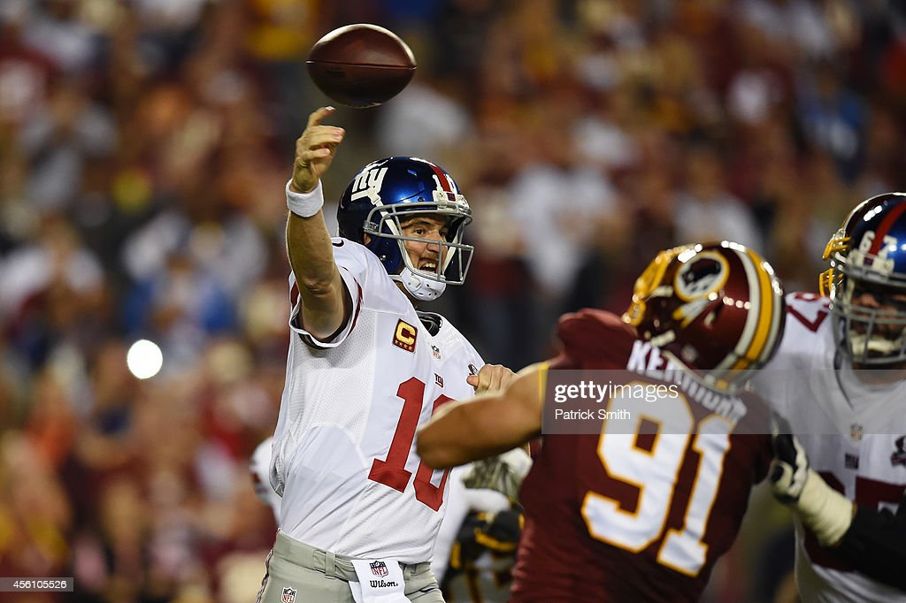 Quarterback Eli Manning of the New York Giants throws against the Washington Redskins during their game at FedExField on September 25 2014 in...