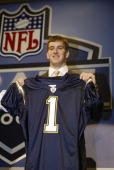 Quarterback Eli Manning was selected first overall by the San Diego Chargers at the 2004 NFL Draft on April 24 2004 at Madison Square Garden in New...