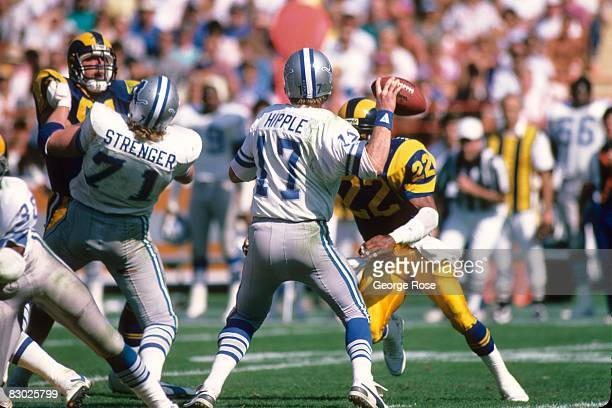 Quarterback Eric Hipple of the Detroit Lions sets to pass against the Los Angeles Rams during a game at Anaheim Stadium on October 19 1986 in Anaheim...