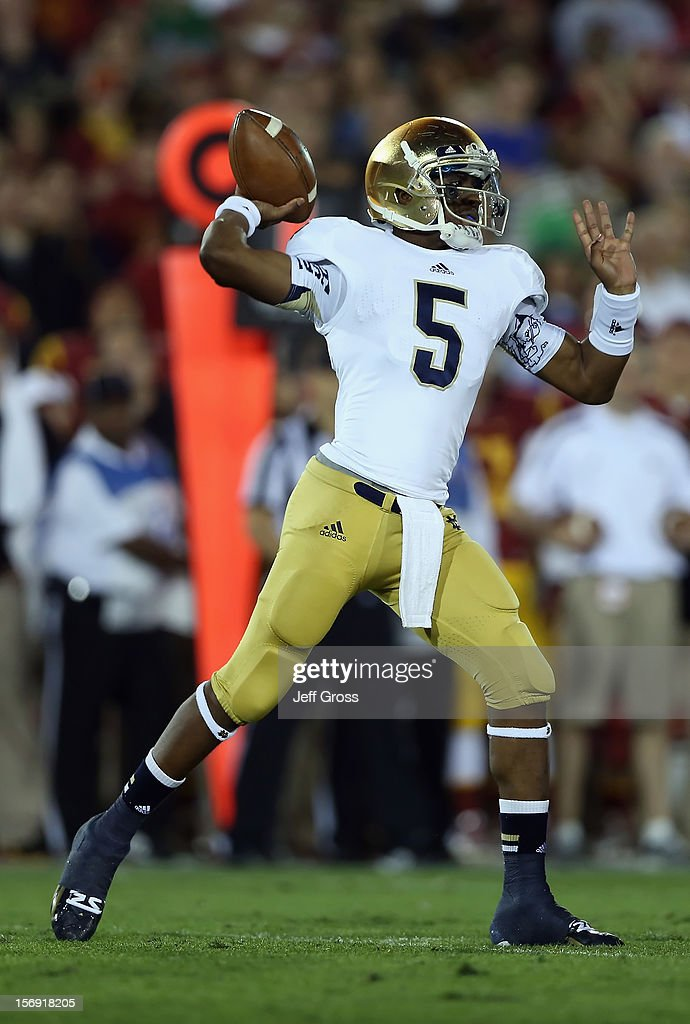 Quarterback <a gi-track='captionPersonalityLinkClicked' href=/galleries/search?phrase=Everett+Golson&family=editorial&specificpeople=9688386 ng-click='$event.stopPropagation()'>Everett Golson</a> #5 of the Notre Dame Fighting Irish drops back to pass against the USC Trojans in the first half at Los Angeles Memorial Coliseum on November 24, 2012 in Los Angeles, California. Notre Dame defeated USC Trojans 22-13.