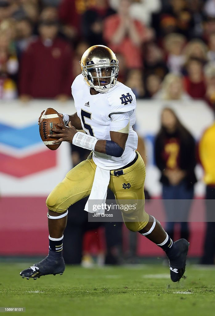 Quarterback <a gi-track='captionPersonalityLinkClicked' href=/galleries/search?phrase=Everett+Golson&family=editorial&specificpeople=9688386 ng-click='$event.stopPropagation()'>Everett Golson</a> #5 of the Notre Dame Fighting Irish looks for an open receiver against the USC Trojans at Los Angeles Memorial Coliseum on November 24, 2012 in Los Angeles, California. Notre Dame defeated USC Trojans 22-13.