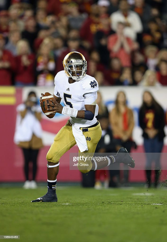 Quarterback Everett Golson #5 of the Notre Dame Fighting Irish looks for an open receiver against the USC Trojans at Los Angeles Memorial Coliseum on November 24, 2012 in Los Angeles, California.