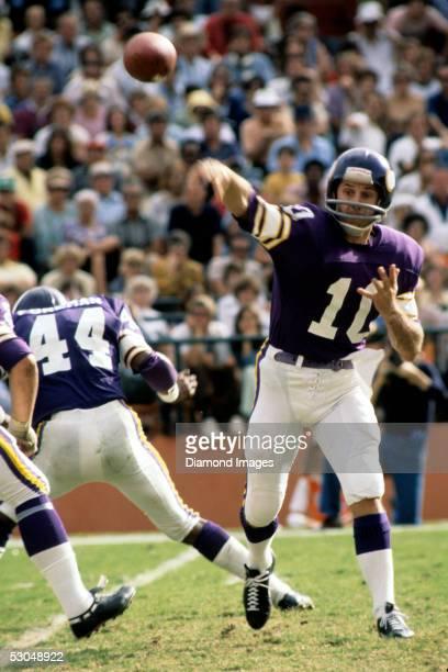 Quarterback Fran Tarkenton of the Minnesota Vikings throws a pass during a game in December 1976