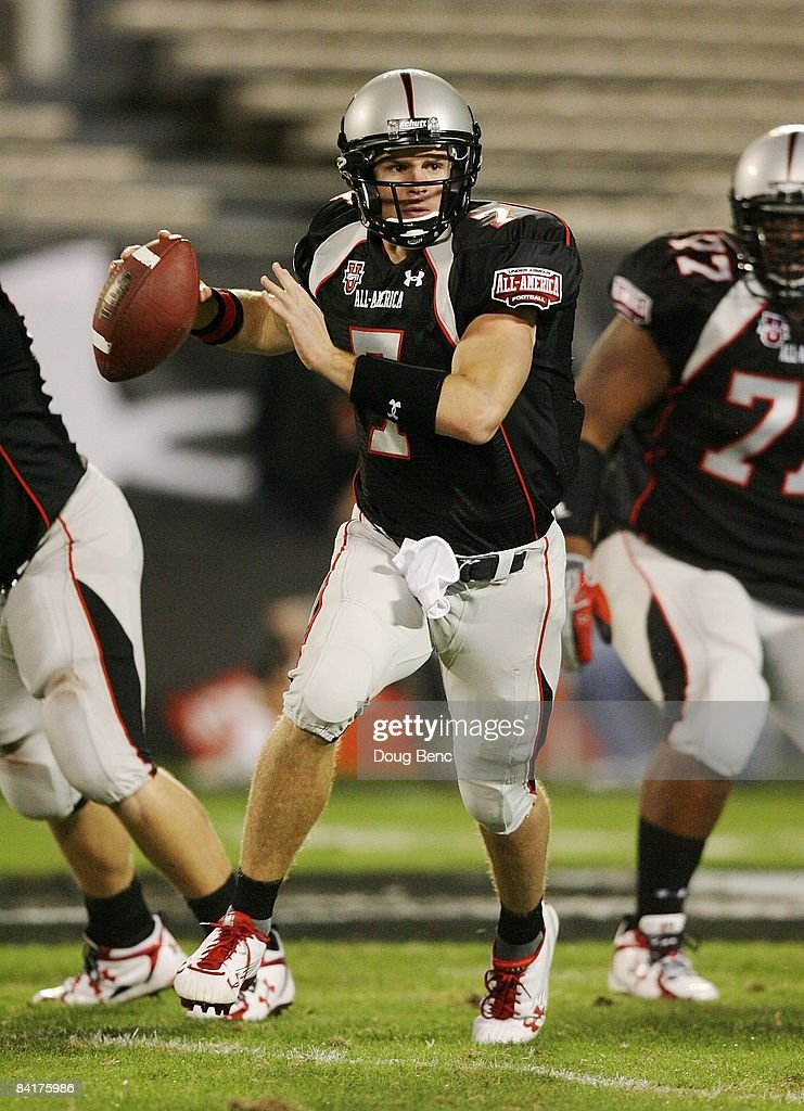Quarterback Garrett Gilbert of the black team rolls out to throw a pass in the All America Under Armour Football Game at Florida Citrus Bowl on...