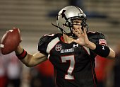 Quarterback Garrett Gilbert of the black team throws a pass in the All America Under Armour Football Game at Florida Citrus Bowl on January 4 2009 in...
