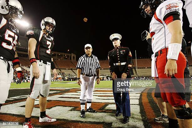 Quarterback Garrett Gilbert of the black team watches the coin flip before the All America Under Armour Football Game at Florida Citrus Bowl on...