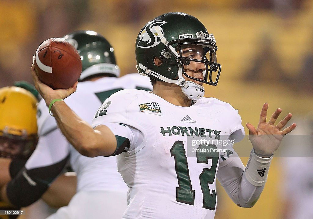 Quarterback Garrett Safron #12 of the Sacramento State Hornets drops back to pass during the college football game against the Arizona State Sun Devils at Sun Devil Stadium on September 5, 2013 in Tempe, Arizona.