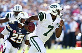 Quarterback Geno Smith of the New York Jets carries the ball against the San Diego Chargers at Qualcomm Stadium on October 5 2014 in San Diego...