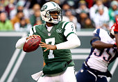 Quarterback Geno Smith of the New York Jets drops back against the New England Patriots during a game at MetLife Stadium on December 21 2014 in East...