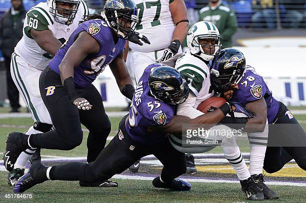 Quarterback Geno Smith of the New York Jets is sacked by outside linebacker Terrell Suggs and Elvis Dumervil of the Baltimore Ravens in the fourth...