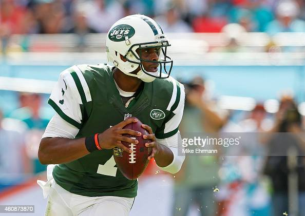 Quarterback Geno Smith of the New York Jets looks for a receiver in the second quarter during a game against the Miami Dolphins at Sun Life Stadium...