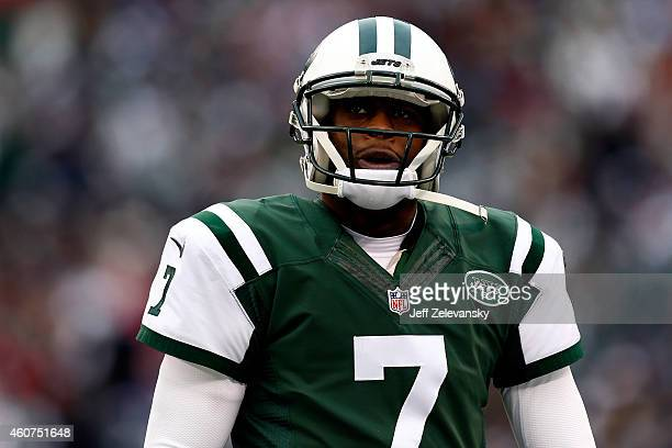 Quarterback Geno Smith of the New York Jets looks on from the sideline against the New England Patriots during a game at MetLife Stadium on December...