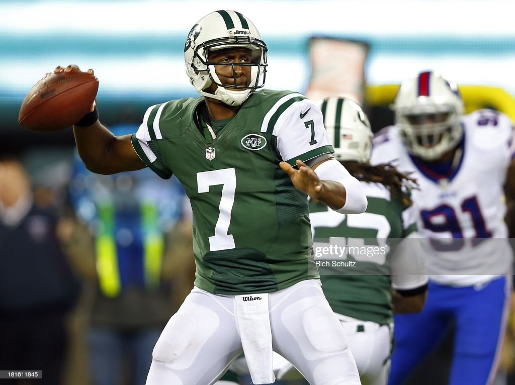 Quarterback <a gi-track='captionPersonalityLinkClicked' href=/galleries/search?phrase=Geno+Smith&family=editorial&specificpeople=6379793 ng-click='$event.stopPropagation()'>Geno Smith</a> #7 of the New York Jets looks to pass against the Buffalo Bills during the fourthd quarter in a game at MetLife Stadium on September 22, 2013 in East Rutherford, New Jersey. The Jets defeated the Bills 27-20.