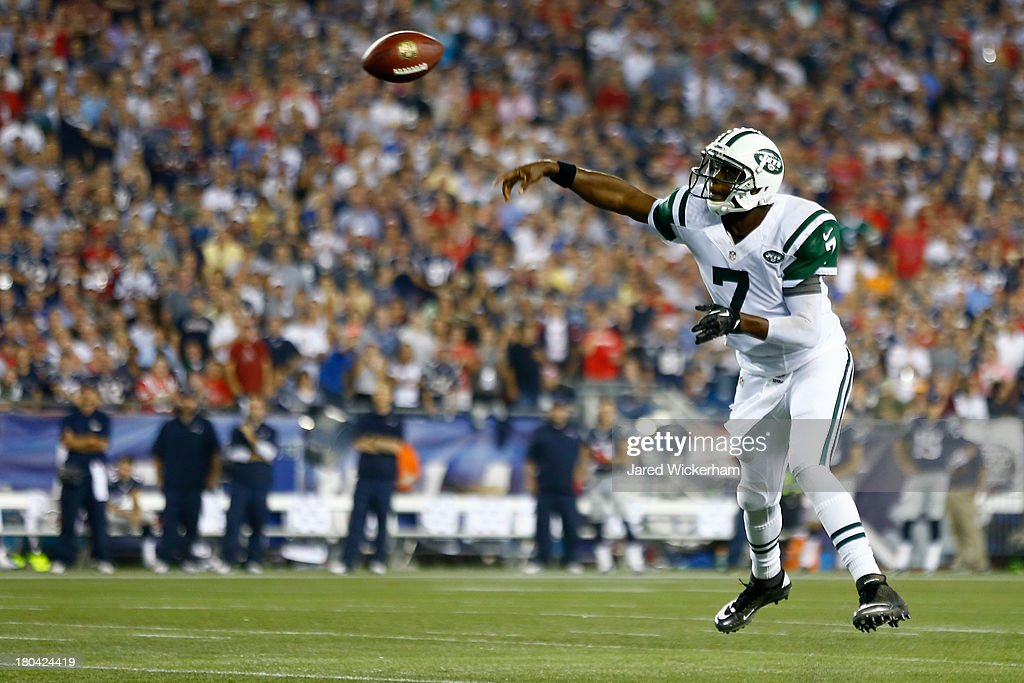 Quarterback <a gi-track='captionPersonalityLinkClicked' href=/galleries/search?phrase=Geno+Smith&family=editorial&specificpeople=6379793 ng-click='$event.stopPropagation()'>Geno Smith</a> #7 of the New York Jets looks to pass in the first quarter against the New England Patriots at Gillette Stadium on September 12, 2013 in Foxboro, Massachusetts.