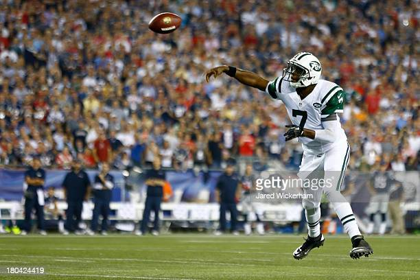 Quarterback Geno Smith of the New York Jets looks to pass in the first quarter against the New England Patriots at Gillette Stadium on September 12...