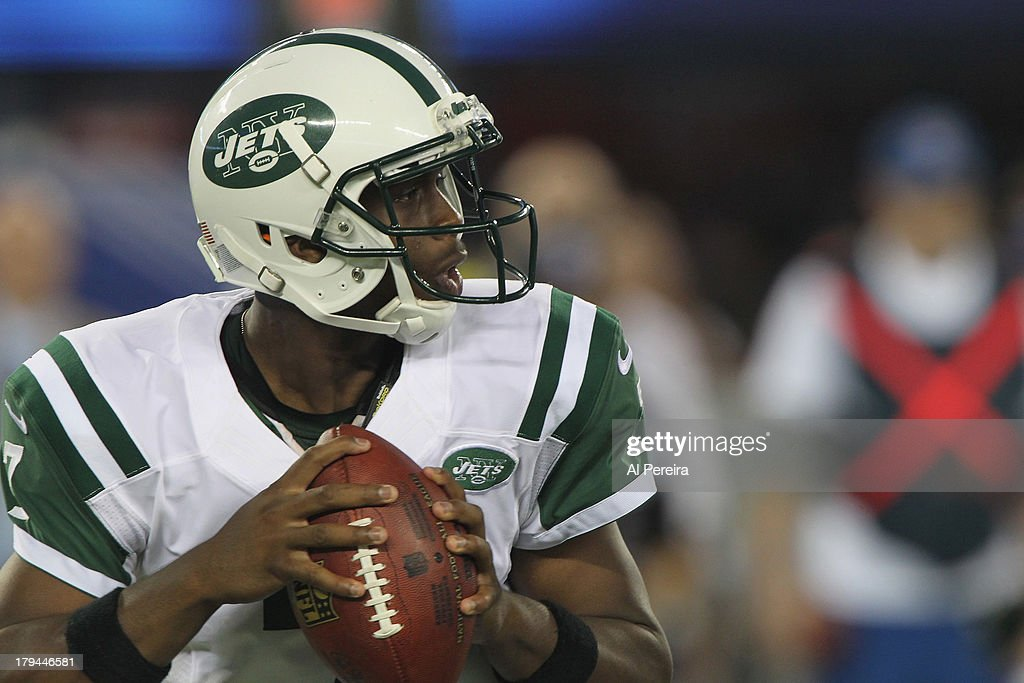 Quarterback Geno Smith #7 of the New York Jets looks to the ball against the New York Giants at MetLife Stadium on August 24, 2013 in East Rutherford, New Jersey.
