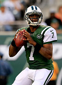 Quarterback Geno Smith of the New York Jets passes against the Indianapolis Colts in the first quarter during a preseason game at MetLife Stadium on...