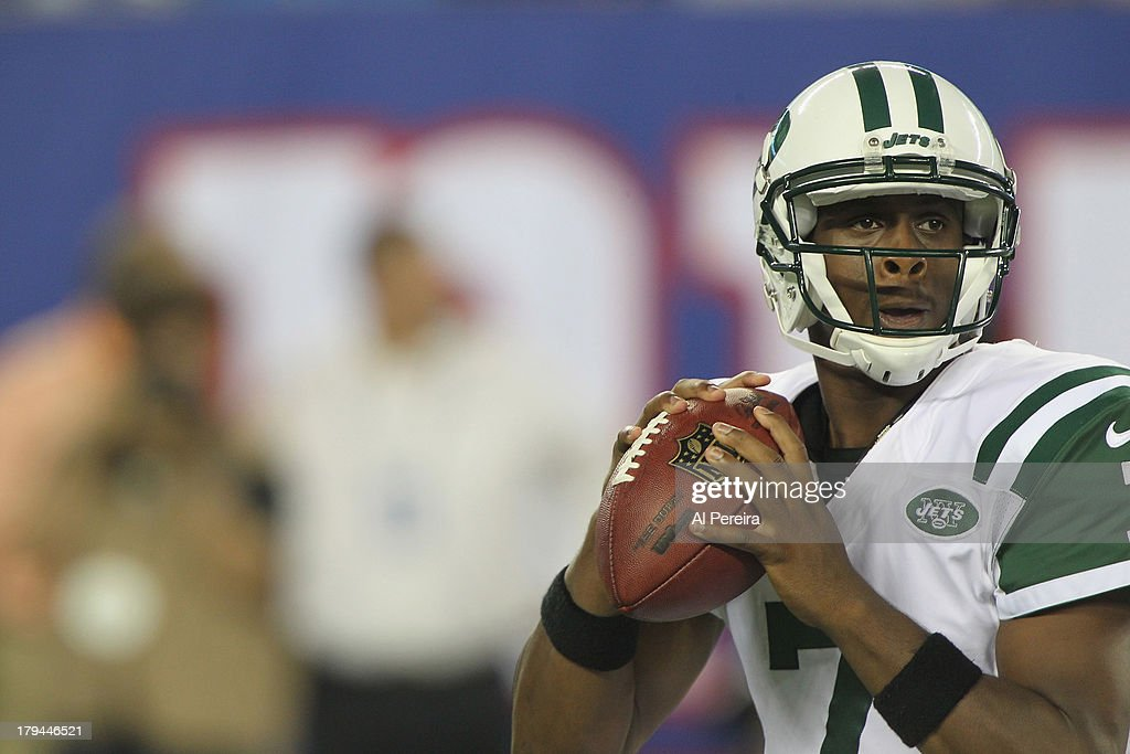 Quarterback Geno Smith #7 of the New York Jets passes the ball against the New York Giants at MetLife Stadium on August 24, 2013 in East Rutherford, New Jersey.