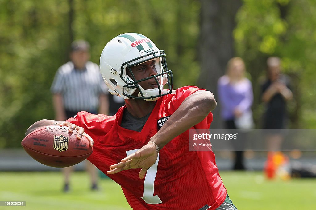 Quarterback <a gi-track='captionPersonalityLinkClicked' href=/galleries/search?phrase=Geno+Smith&family=editorial&specificpeople=6379793 ng-click='$event.stopPropagation()'>Geno Smith</a> #7 of the New York Jets passes the ball during New York Jets Rookie Minicamp on May 10, 2013 at the Atlantic Health Jets Training Center in Florham Park, New Jersey.