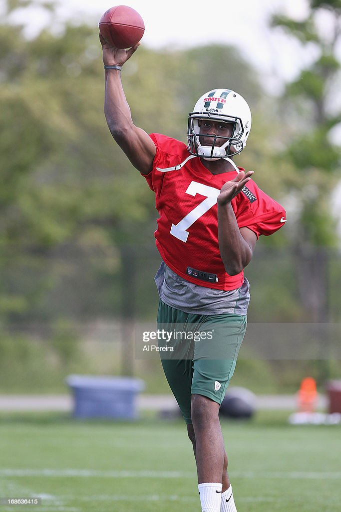 Quarterback <a gi-track='captionPersonalityLinkClicked' href=/galleries/search?phrase=Geno+Smith&family=editorial&specificpeople=6379793 ng-click='$event.stopPropagation()'>Geno Smith</a> #7 of the New York Jets passes the ball during New York Jets Rookie Minicamp at the Atlantic Health Jets Training Center on May 11, 2013 in Florham Park, New Jersey.