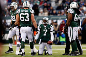 Quarterback Geno Smith of the New York Jets reacts against the New England Patriots during a game at MetLife Stadium on December 21 2014 in East...